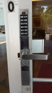 push button lock installed on a storefront door