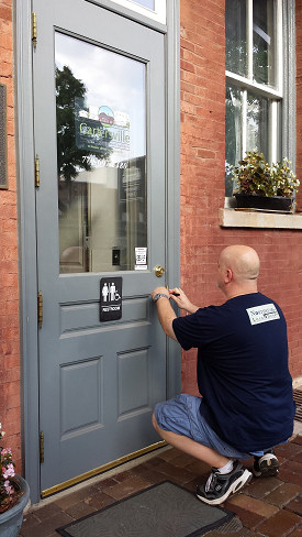 Northstar Locksmiths working on a lock at the Cartersville Welcome Center