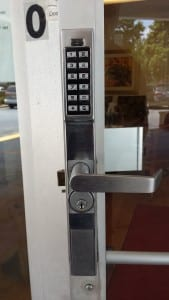 push-button lock installed on a storefront door