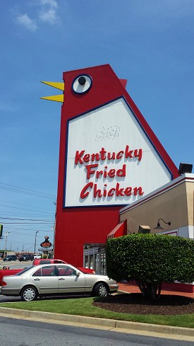 locksmith doing work and the big chicken in Marietta