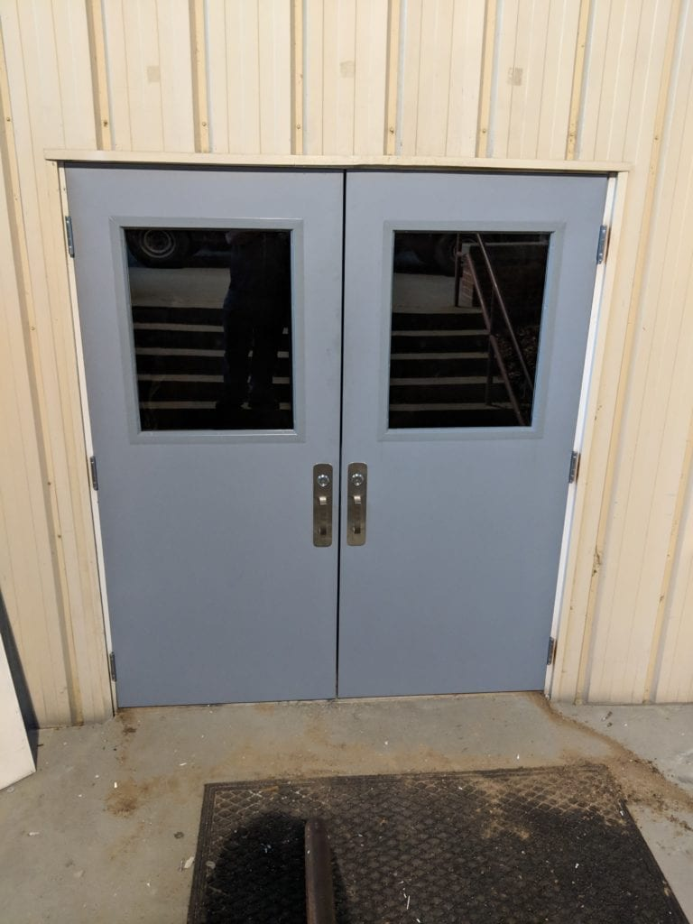Two freshly installed hollow metal doors that Northstar Locksmiths installed on a church in Marietta