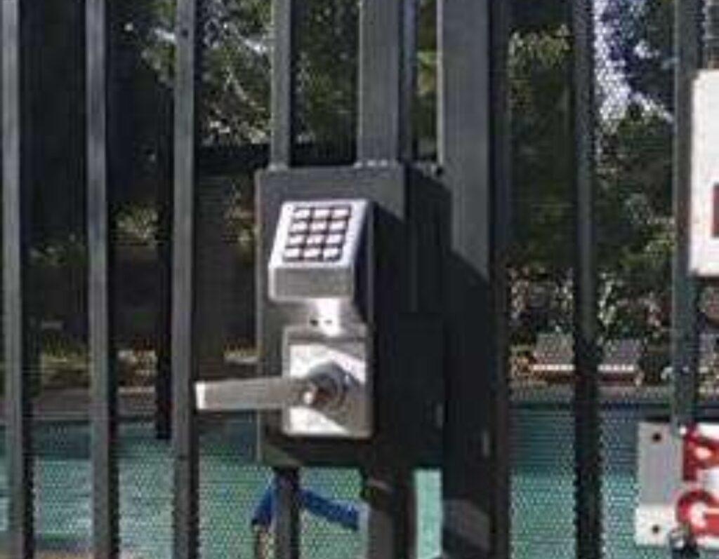 Pool gate lock by alarm lock